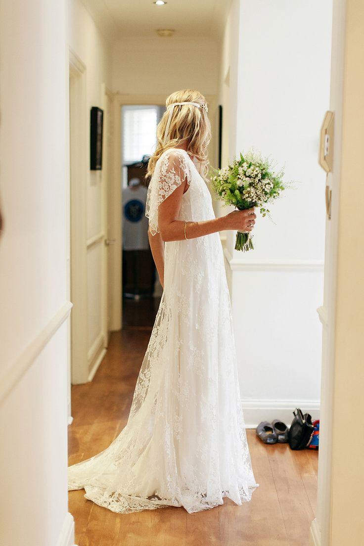 Bride wears a lace Delphine Manivet Gown | Photography by http://www.bohemianweddings.co.uk/