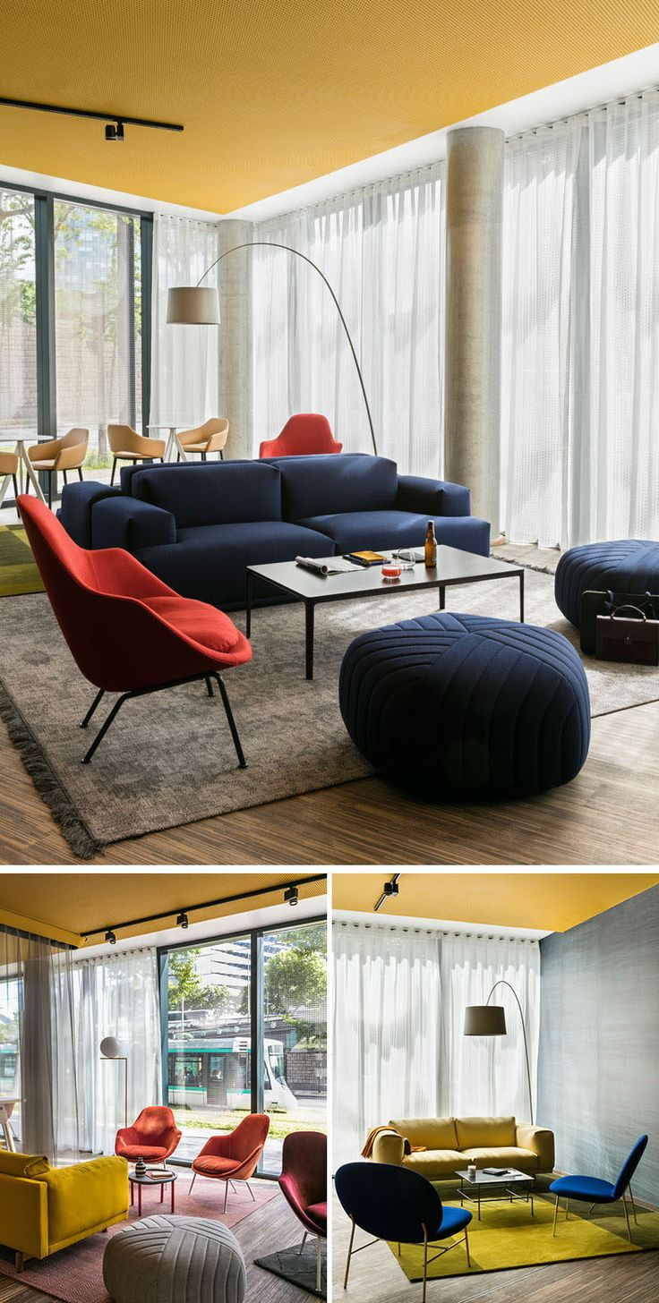 Inside this modern French hotel and in the lobby, bright colors and comfortable seating is surrounded by light-weight floor-to-ceiling curtains, while a pop of color draws your eye upwards to the ceiling.
