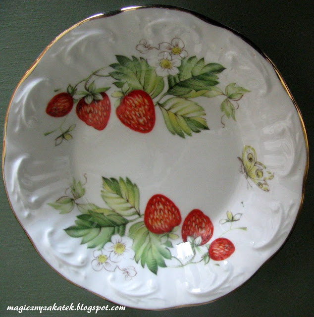 Plate with wild strawberries