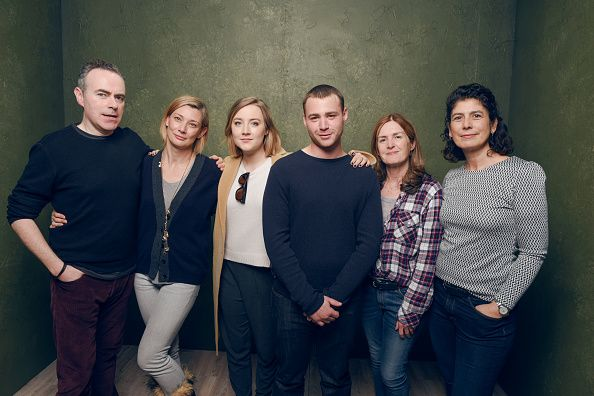 Director John Crowley actress Saoirse Ronan actor Emory Cohen and producer Amanda Posey of 'Brooklyn' pose for a portrait at the Village at the Lift...