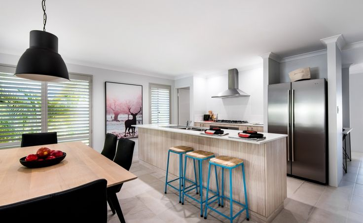 Galley kitchen with Caesarstone benchtops, 900mm stainless steel oven, hotplate and rangehood with tiled splashback and large walk-in pantry