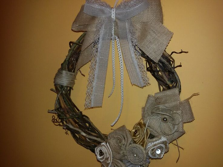 natural whreath decorated with burlap