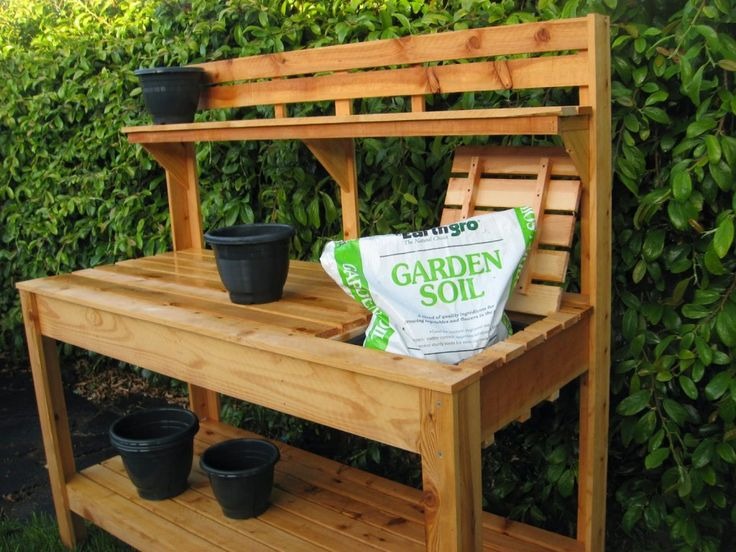 Soft Brown Light Wood Potting Table With Some Black Plastic Pot And Green For Fance Outdoor Cool Outdoor Potting Table Home Depot Plans Ideas