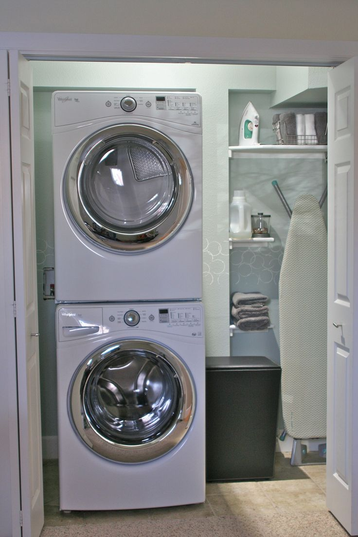stacked washer dryer laundry room with mud room design