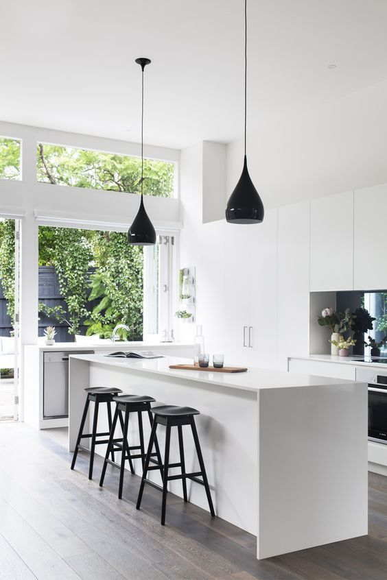aesthetic white kitchen with several black accents looks airy and bright
