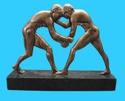Greek wrestling, also known as Ancient Greek wrestling and Pále, was the most popular organized sport in Ancient Greece. A point was scored when one player touched the ground with his back, hip, shoulder, or tapped out due to a submission-hold or was forced out of the wrestling-area. Three points had to be scored to win the match.