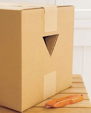 Moving Tip: Cut triangles in the sides of boxes for easy DIY handles