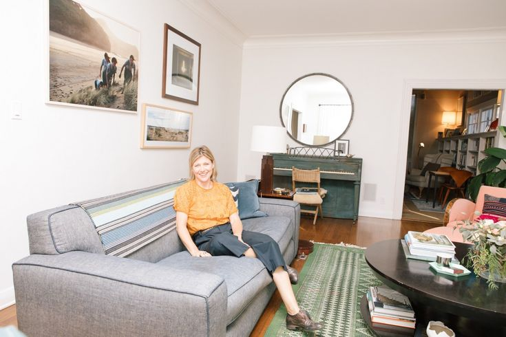 Inside Author Christine Lennon's Los Angeles Home: Finding the home, after years of searching in L.A. was all fine and good, but decorating it was another task altogether.---- Justine Kurland photograph  and denim sofa. | Coveteur.com