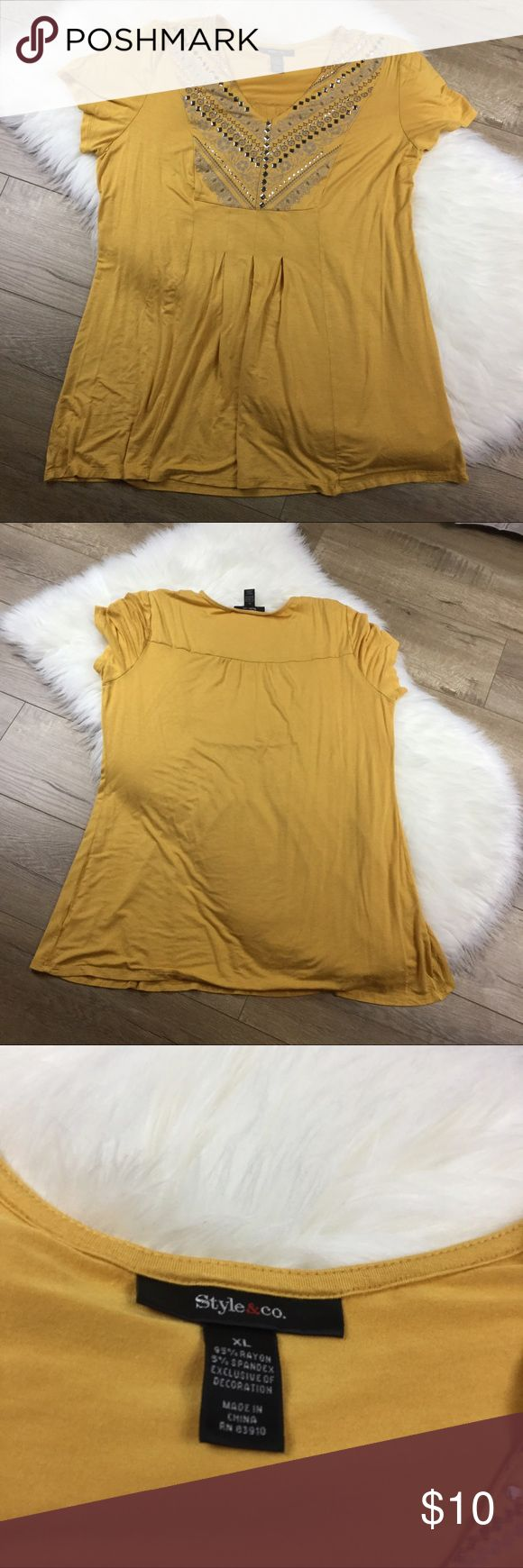 Style & Co em blushed short sleeve top Golden yellow short sleeve shirt from style & co. Size XL, additional measurements available in photo. Does have some small holes, one was repaired, on the bottom one upper body. All pictured. Has embellished neckline and pleading in the front. Save 20% when bundled. Style & Co Tops Tees - Short Sleeve