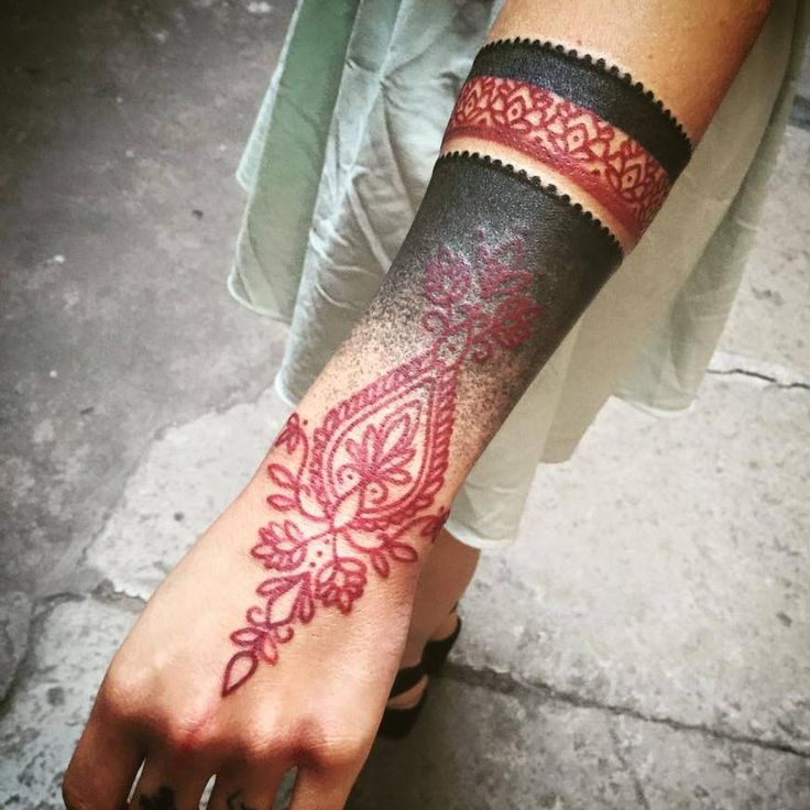 Black & Red Wrist Tattoo  http://blog.tattoodo.com/2016/01/stylish-tattoos-dodie/