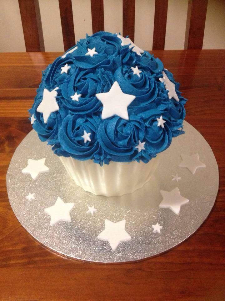 Boys giant cupcake with stars for a 1st birthday cake smash photo shoot.