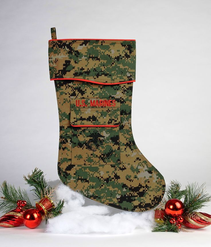 Our beautifully tailored Marine Corps Christmas stocking in the digital woodland camouflage fabric is a real favorite. Makes a perfect addition to a Christmas Gift Package.  Trimmed in scarlet piping with the Marine Corps EG&A emblem embroidered on the stocking pocket it is guaranteed to be a hit.  www.camosock.com