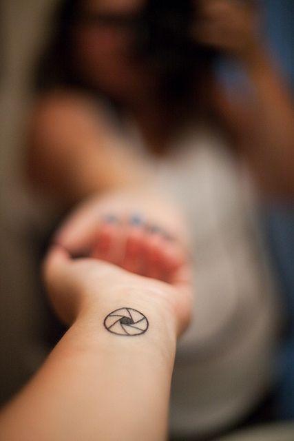 @Mishelle Lane of Secret Agent Mama - Aperture Tattoo on Wrist@Mishelle Lane