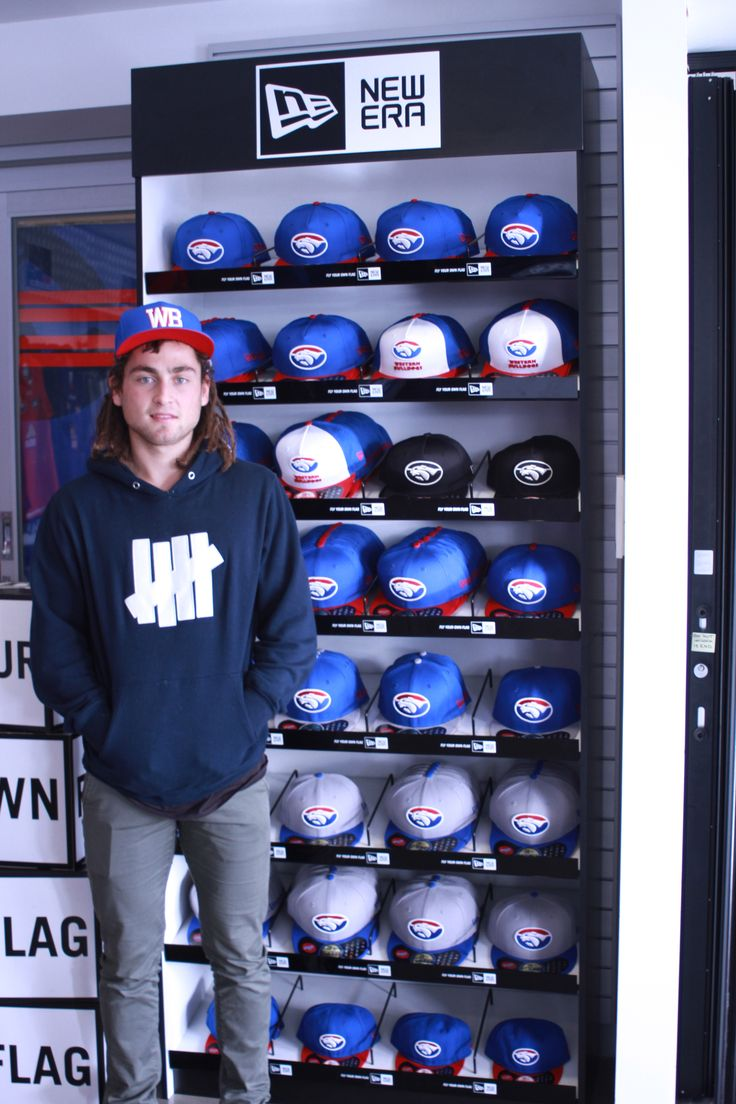 Western Bulldog Luke Dahlhaus (pre head shave for charity!) checking out the New Era wall in store in the WB Limited Editon Cap! https://shopdesq.imgstg.com/index.cfm?fuseaction=Product&CategoryID=2908&ProductID=36773&OrgID=1679