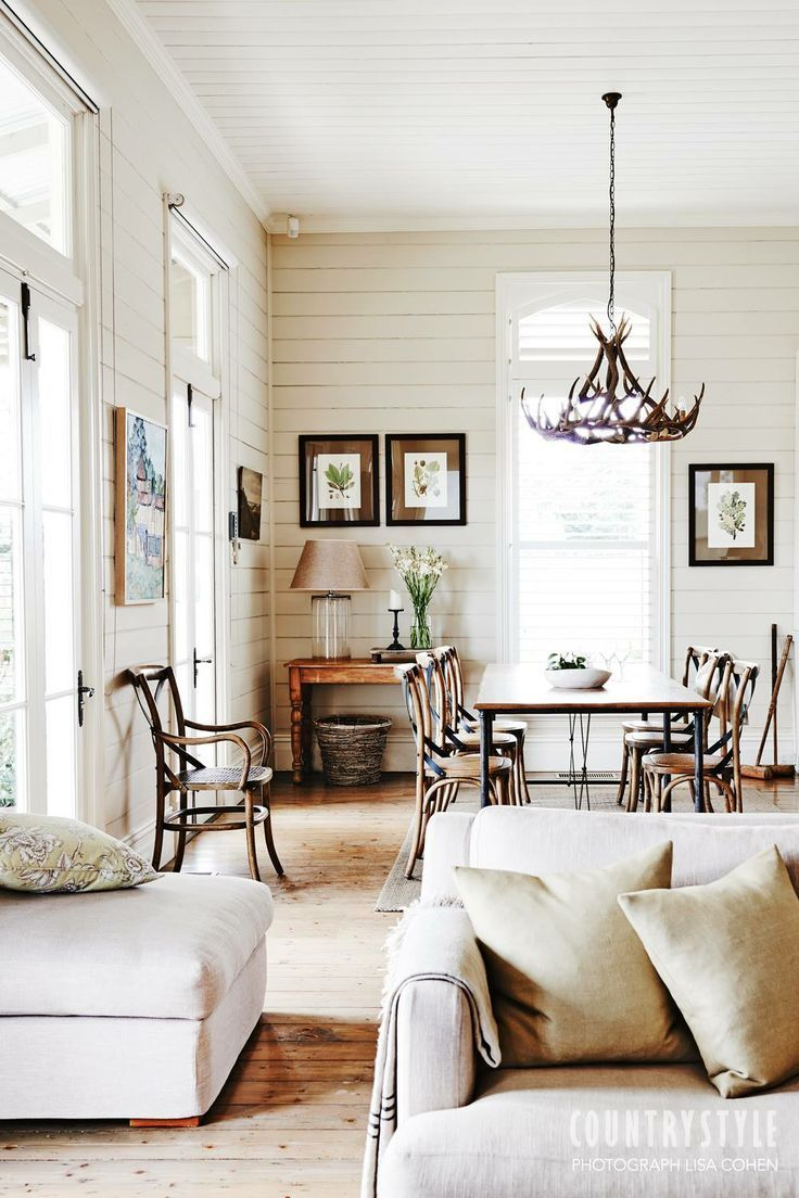 Shiplap walls pair beautifully with wood and linen furniture with rustic accents.