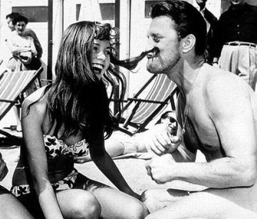 fabulousdestiny:  Brigitte Bardot and Kirk Douglas in Cannes, 1953.