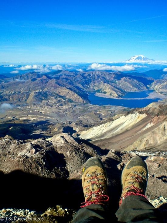 This photo was taken from the crater rim of the active volcano Mt. St. Helens in Washington State. In May of the1980 erupution, 1500 feet of the mountain was obliterated and blown into the atmosphere. Spirit Lake was pushed more than a quarter mile back and the lake level rose by over a hundred feet from ash and debri. Earthquakes are frequent and send rocks tumbling down into the crater walls.
