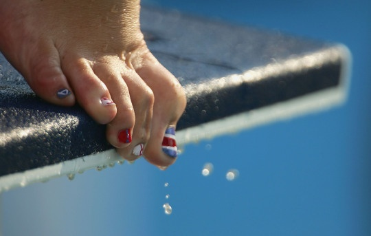 The Painted toenails of Claudia Poll of Costa Rica are pictured during a training session prior to the Athens 2004 Summer Olympic Games, Aug. 12, 2004, in Athens, Greece.
