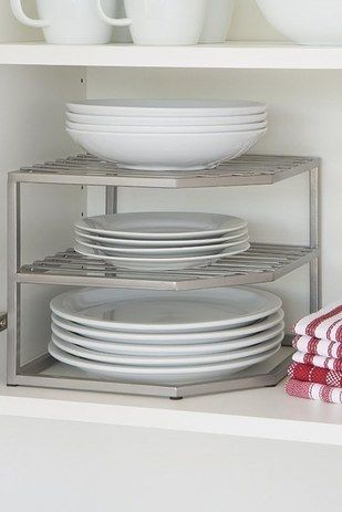 A two-tier shelf that'll give you extra space for all the dishes you never wash. It's okay, you're not alone. | 33 Organization Products Under $20 That Are Worth Your Money