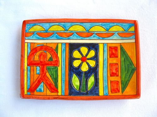 Spanish ceramic oblong plate ~ Indalo, flor. A gift with meaning (and soul) from Andalucía, Spain. This colourful Spanish plate is something really special. Each one is individually hand-painted in the Almeriense Alpujarras, close to Granada, and features the lucky Indalo symbol of the area. It is a blaze of rich, vibrant colours, each one hand-crafted from the local clay. It has a lovely rustic quality - and is full of the soul of Andalucía.