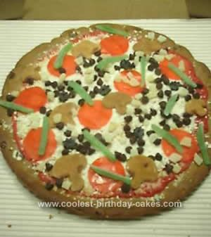 "Homemade Pizza Birthday Cake Design: Finding a birthday cake idea for the pre teen boy is near impossible! I started this Pizza Birthday Cake Design with a 20"" circular white cake (baked"