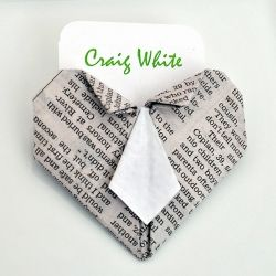 Create this origami necktie heart place card holder.  Perfect for parties, showers or weddings