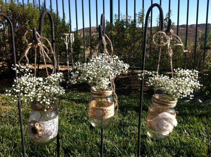 Beautiful decorations using Shepherd Hooks, Glass jars, hessian strips and flowers