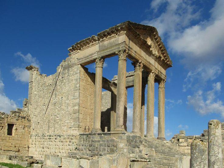 The 2nd century AD Capitoline Temple at Dougga, Tunisia, was dedicated to Rome's protective triad: Jupiter Optimus Maximus, Juno Regina, and Minerva Augusta.