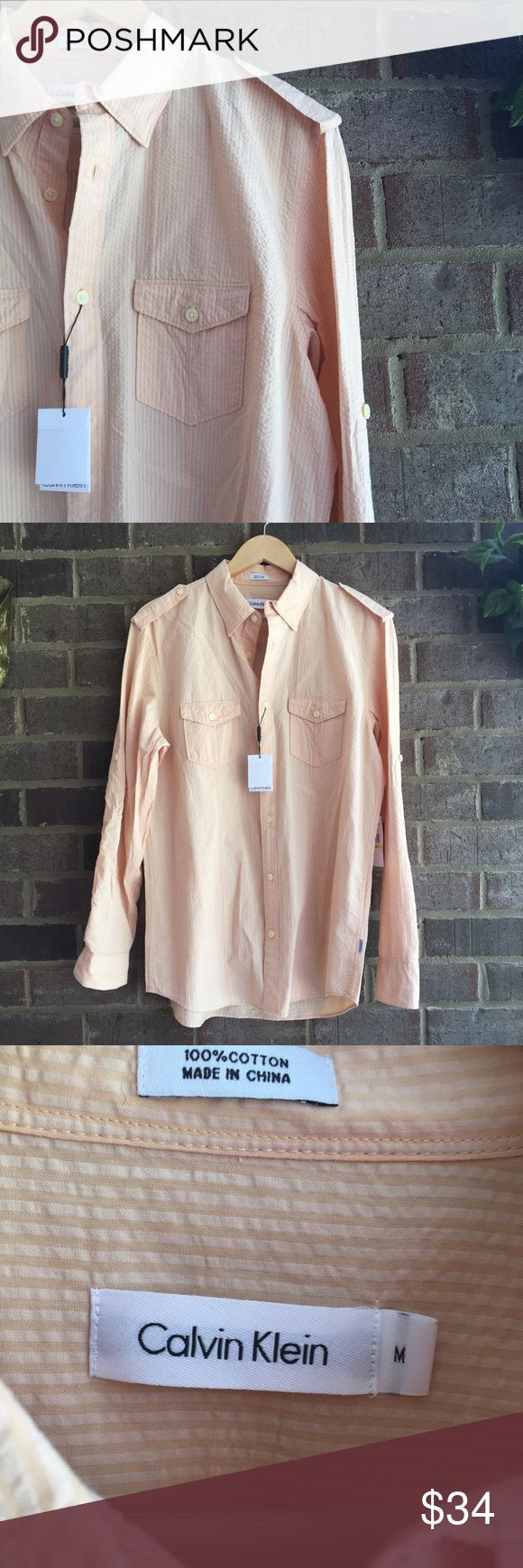 """Men's Calvin Klein NWT Peach Striped Dress Shirt This NWT Button Down shirt is in excellent condition. Made from 100% cotton. Textured fabric. 31"""" long. 10527 Calvin Klein Shirts Dress Shirts"""