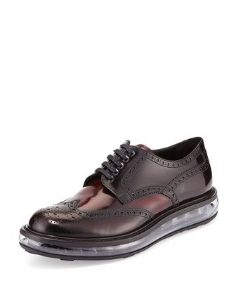 Levitate Leather Wing-Tip Derby Shoe, Dark Red by Prada at Neiman Marcus.