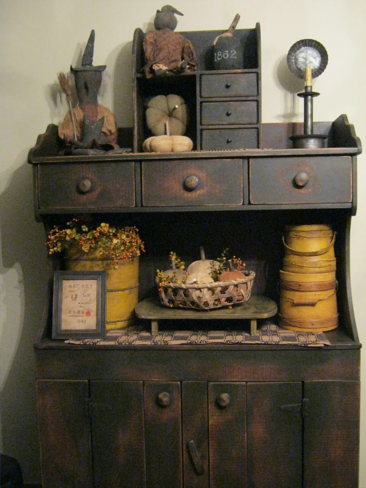 Love this buffet/hutch..a little too country-primitive for me..there needs to be some plactic baby doll heads in there..break it up a little..