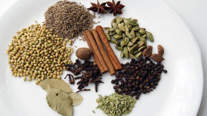 The spices of garam masala can include (clockwise from top left): cumin, star anise, cardamom seeds, black cardamom, black peppercorns, fennel seeds, bay leaf, coriander seeds, cinnamon stick, cloves and nutmeg.