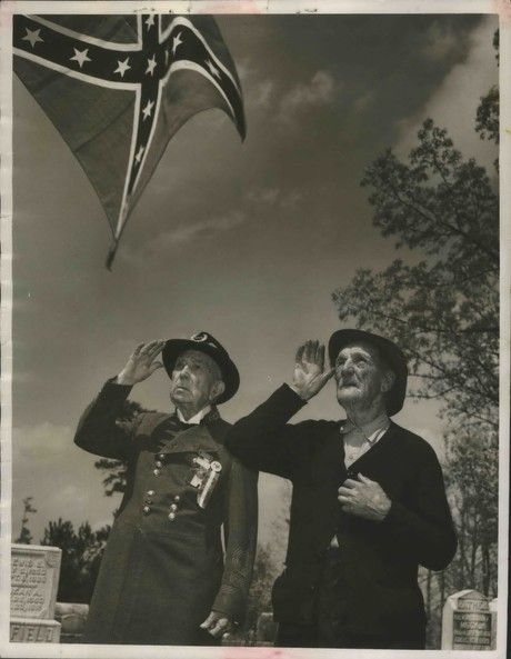Jeremy Gray | jgray@al.com Saluting the rebel flag, 85 years after the war's end General James W. Moore and Colonel P.R. Crump, Confederate veterans, pictured on April 27, 1950.
