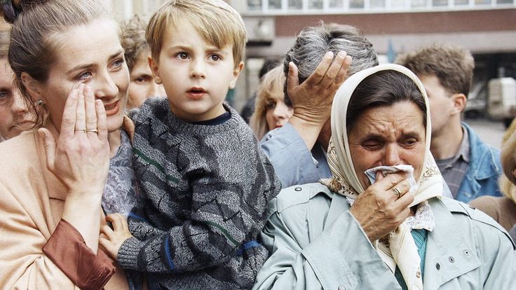 Siege of Sarajevo:  More than 10,000 people were killed during the siege of Sarajevo which began in 1992 and lasted over three and a half years. Here Zimeta Smaic (left) and family members cry as a relative is evacuated from Sarajevo State Hospital, 30 April 1994. Photograph by Peter Northall/Associated Press.