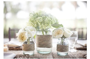 "jars with twine and flowers to hang from ""pews"" or chairs down the aisle. What do u think??"