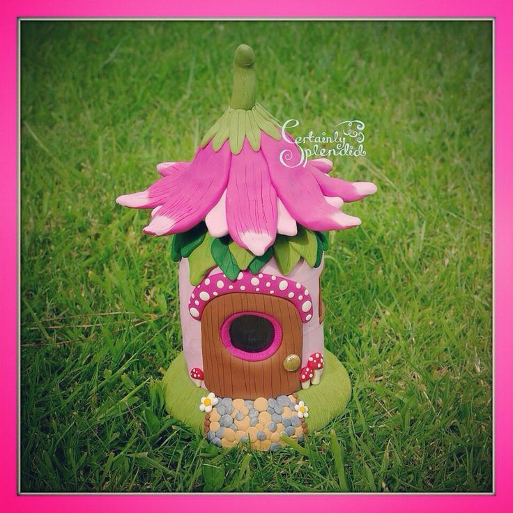 Funky fimo pink fairy house with flowers and toadstools. Made from polymer clay and jam jars so it has real glass windows! Cute bespoke handmade crafts from Certainly Splendid www.facebook.com/certainlysplendid xxx