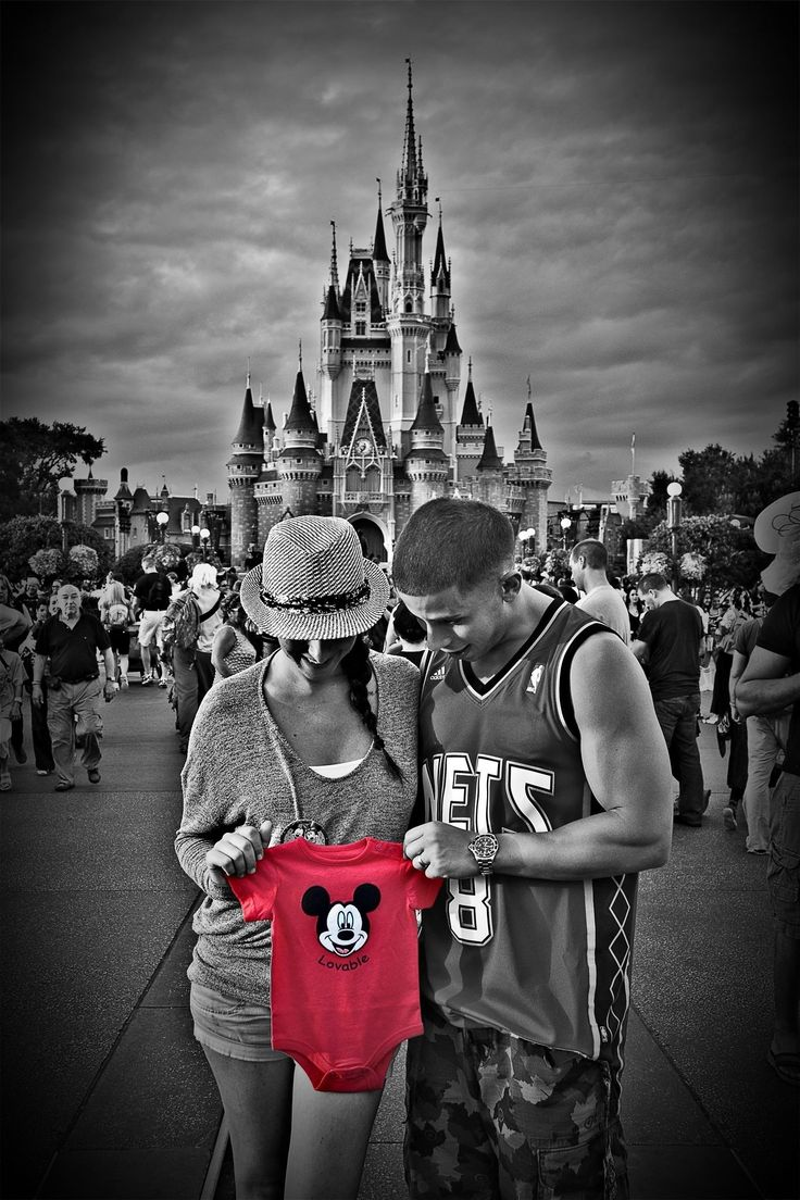 Pregnancy reveal with my husband in Disney 9/2013 for our 1 year wedding anniversary vacation.