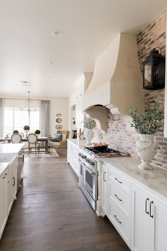White Kitchen White Cabinets Brick Backsplash In 2020