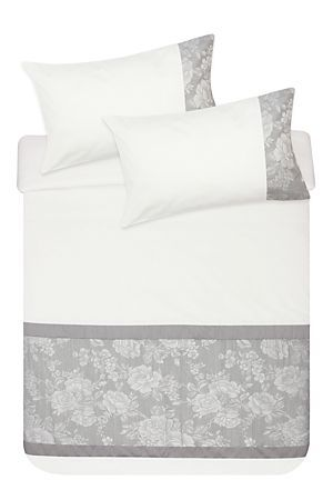 "This elegant rose jacquard duvet cover set has a polycotton cuff for added interest and will add a feminine touch to any bedroom setting. Single and three quarter include 1 standard pillowcase, double, queen and king include 2 standard pillowcases.<div class=""pdpDescContent""><BR /><BR /><b class=""pdpDesc"">Fabric Content:</b><BR />50% Polyester 50% Cotton<BR /><BR /><b class=""pdpDesc"">Wash Care:</b><BR>Lukewarm machine wash</div>"