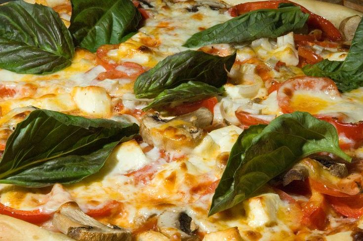 Photo of Pizza with Vegetables and Cheese