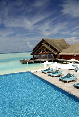 The Maldives. I keep seeing pics from here lately...I am definitely adding it to my list of places to go.