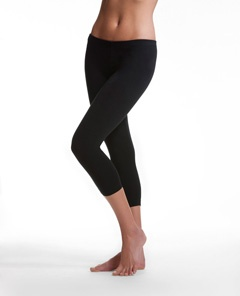 Danskin Womens Mid-Rise Capri Legging – 8996 (55% cotton, 35% polyester, 10% spandex).  The only thing I ever workout or run in: comfy, no chub-rub, no muffin-top and no camel-toe (things that cannot be said about most stretch-athletic pants/shorts)   $24