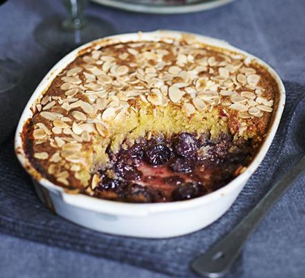 Cherry Bakewell sponge pudding  Cherry and almond is a heavenly combination. This fruity dessert has a sponge top and crunchy finish. Serve with plenty of custard