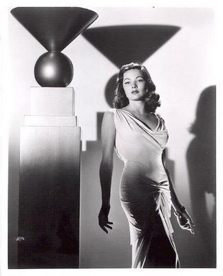 The Laura Gown. Worn by Gene Tierney in the 1944 Film Noir classic, this white jersey is a tour de Force in simplicity and drapingby 20th Century Fox designer Bonnie Cashin. Cashin was a designer who moved around a lot not only through the movie industry, she switched back and forth from Hollywood, to Broadway to Seventh Avenue.