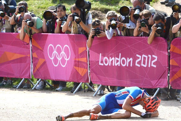 Czech Republic's Jaroslav Kulhavy is celebrating his exhausting victory in the men's cycling cross-country mountain bike race