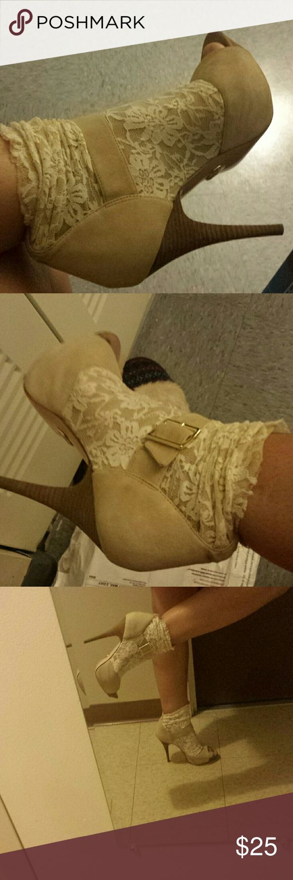 Hello I am selling a pair of cream high heel Cream high heels with ankle socks connected together very funky it's made by Betsey Johnson Betsey Johnson Shoes Ankle Boots & Booties
