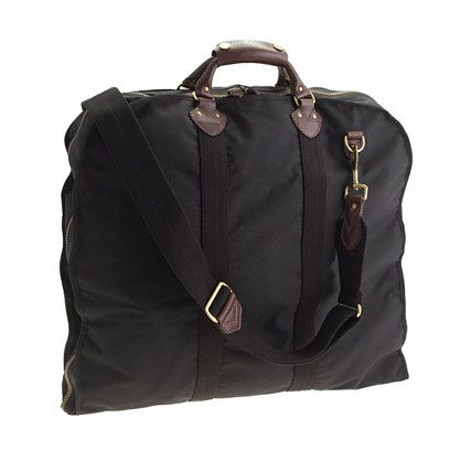 """Look after your investments. Trade out that flimsy bag that was only meant to get your suit from the store to your closet for some real armor that can take the worst of what airlines have to offer. 3"""" handle drop. 41""""H x 21 3/4""""W x 4 1/4""""D. Adjustable shoulder strap fully extends to 51 1/2"""". Nylon, leather."""