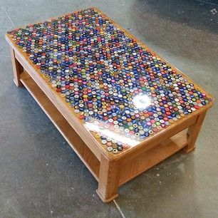 Drink a lot of beer? Save the bottle caps until you have enough to cover a table. | 31 Incredibly Creative Ways To Display All Your Stuff