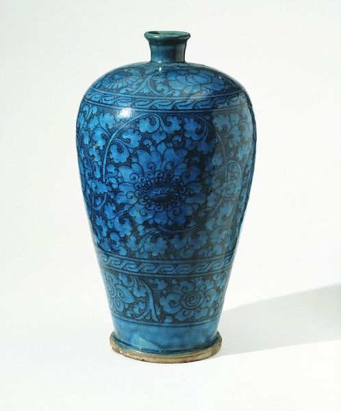 Chinese Handan stoneware decorated in black under a turquoise glaze, 1300-1400. this design was influenced by Syrian ceramics.