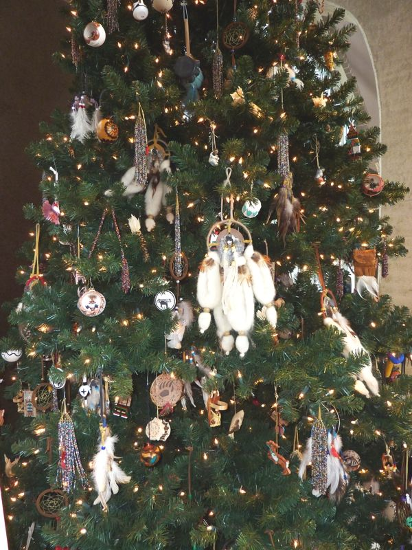 The Native American Christmas Tree is filled with hand made ornaments celebrating the     Native American crafts and culture.